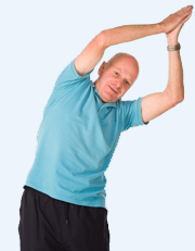 Mature older man doing yoga